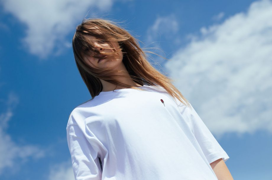 blonde woman with white t shirt with tampon